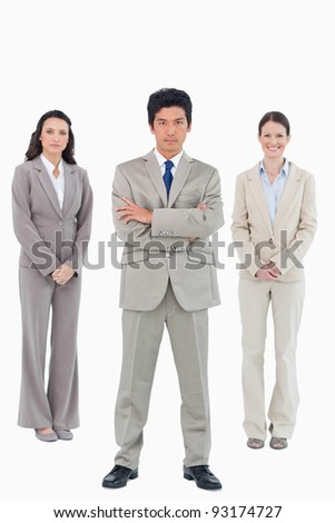 Confident businessman with his team behind him against a white background