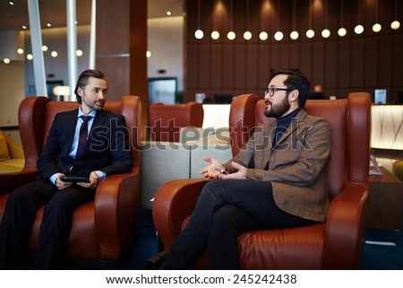 Confident businessmen discussing ideas and strategies - stock photo