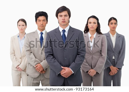 Confident businessteam standing against a white background
