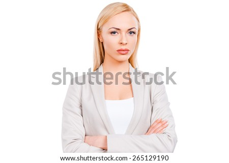 Confident businesswoman. Confident mature businesswoman keeping arms crossed while standing against white background - stock photo