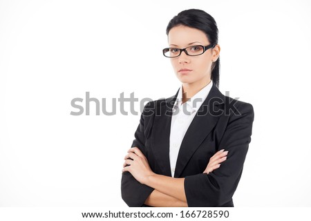 Confident businesswoman. Confident young business woman looking at camera and keeping her arms crossed while standing isolated on white - stock photo