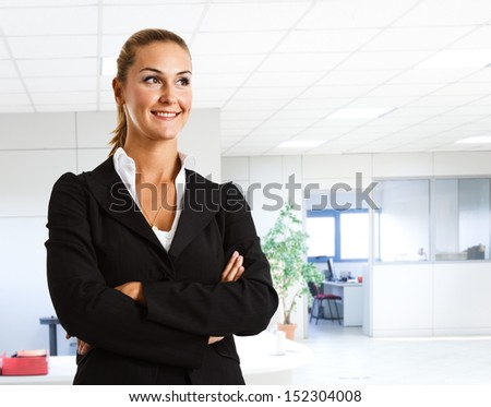 Confident businesswoman in her office - stock photo