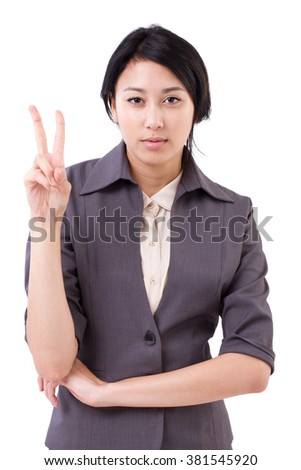 confident businesswoman pointing up 2 finger victory gesture - stock photo