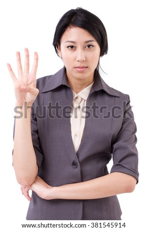 confident businesswoman pointing up 4 fingers gesture - stock photo