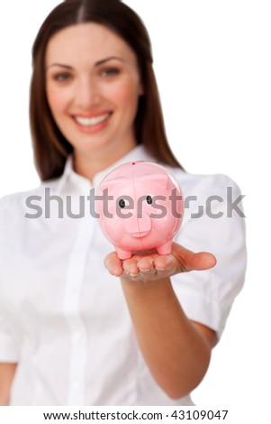 Confident businesswoman showing a piggybank against a white background - stock photo