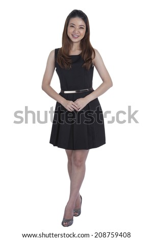 Confident businesswoman standing full length in black suit. Businesswoman or real estate agent isolated on white background. - stock photo
