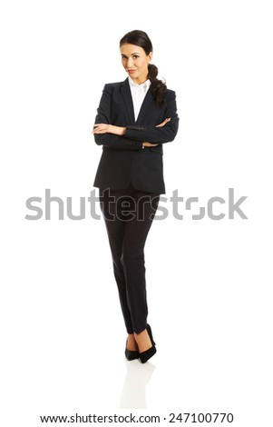Confident businesswoman standing with folded arms. - stock photo