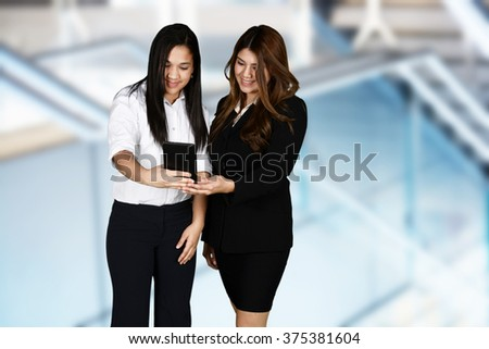 Confident businesswoman who is ready for work - stock photo