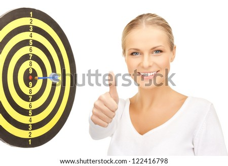 confident businesswoman with dart and target showing thumbs up.. - stock photo