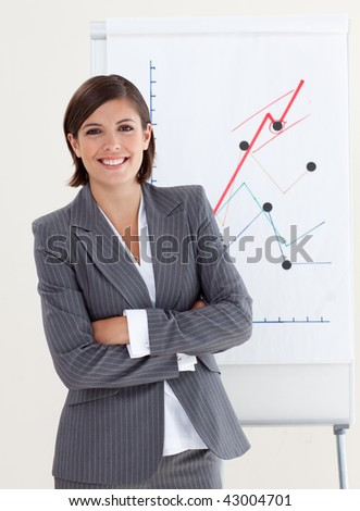 Confident businesswoman with folded arms at a presentation - stock photo