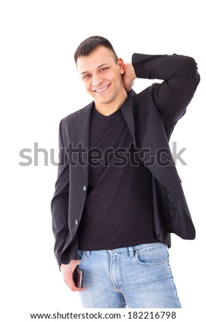 confident casual man in a black suit jacket and jeans - stock photo