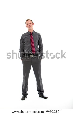 Confident casual smiling handsome businessman in stylish outfit posing full length facing camera with his hands in his pockets isolated on white - stock photo