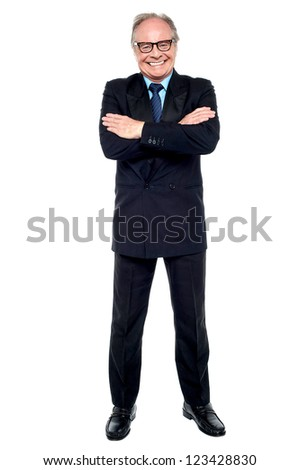 Confident cheerful matured businessperson posing with folded arms. - stock photo