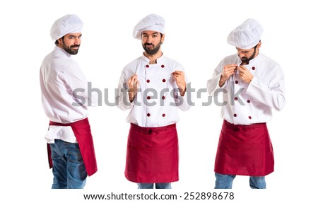 Confident chef over white background - stock photo