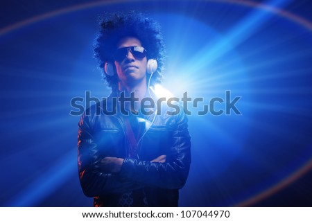 Confident dj portrait with club lights lens flare and retro man with afro and headphones