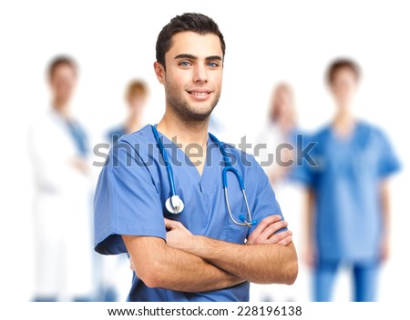Confident doctor in front of his medical team  - stock photo