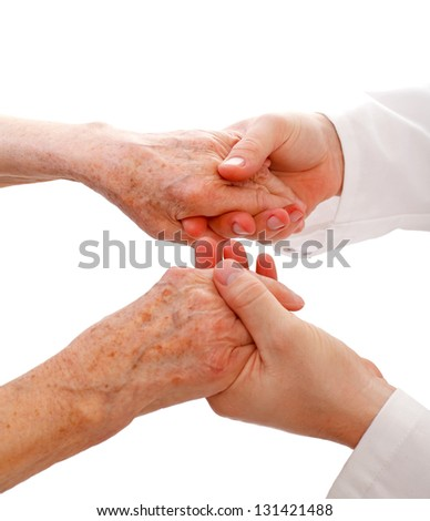 Confident doctor is holding the patient hands - stock photo