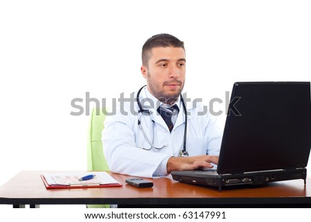 Confident doctor man working on laptop in office