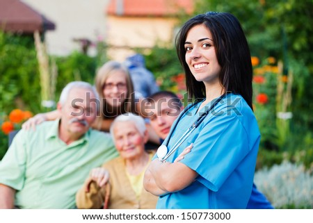 Confident doctor welcoming the family in residential care home.