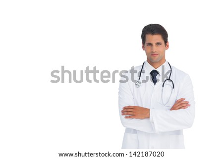 Confident doctor with arms crossed on white background