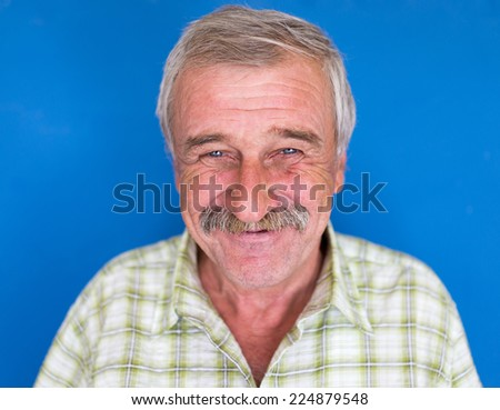 Confident elderly good looking man - stock photo