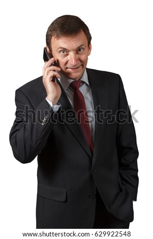 Confident elegant handsome mature businessman  wearing a nice suit is speaking on the sell phone on white isolated background