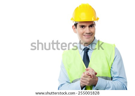 Confident engineer holding his hands clasped - stock photo