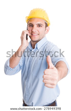 Confident engineer showing thumb up while talking on phone on white background