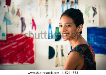 Confident entrepreneur, portrait of happy hispanic young woman working as fashion designer and dressmaker in atelier