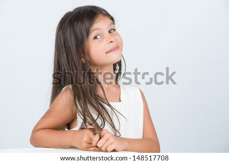Confident expression from little girl half body - stock photo
