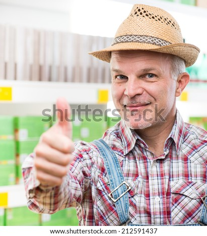 Confident farmer at supermarket with thumbs up, looking at camera.