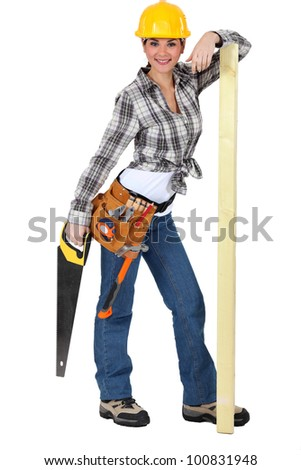 Confident female carpenter standing on white background - stock photo