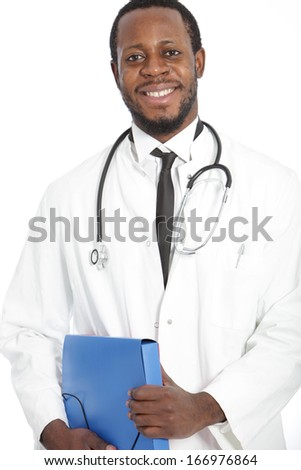 Confident friendly African doctor with a stethoscope around his neck and carrying a folder of patient records standing smiling at the camera, on white