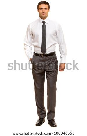 Man wearing white dress shirt standing sideways.