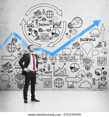 Confident handsome businessman is thinking about further business development. Business optimisation flowchart on the concert wall. - stock photo
