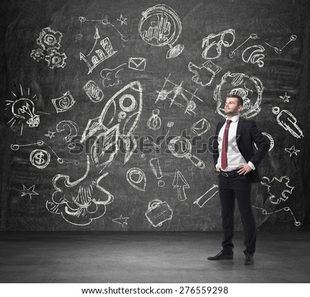 Confident handsome businessman is thinking about future business opportunities. Business optimisation flowchart on the concert wall. - stock photo