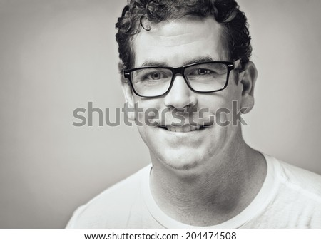 Confident handsome man closeup black and white toned portrait  - stock photo