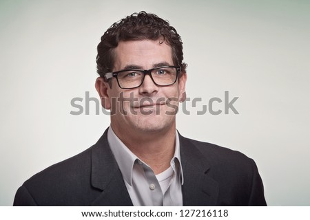 Confident handsome professional man with glasses - stock photo