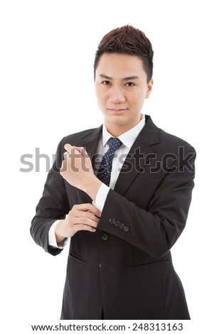 Confident handsome Vietnamese businessman smiling and looking at the camera