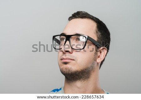 Confident handsome young man portrait - stock photo