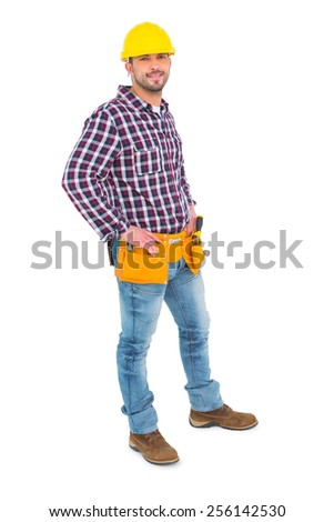 Confident handyman standing with hands on hips over white background