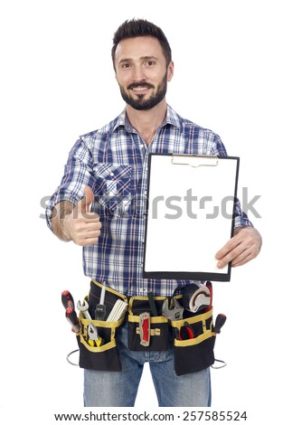 Confident handyman with clipboard - stock photo