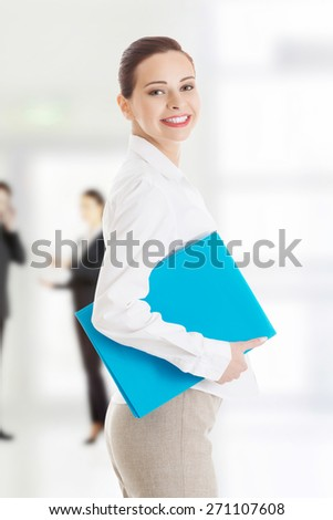 Confident happy businesswoman with notepad. - stock photo