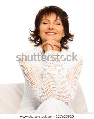 Confident happy senior adult woman sitting and smiling with hands hold together - stock photo
