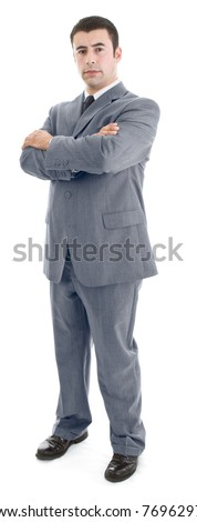Confident Hispanic Man Standing with Arms Crossed - stock photo