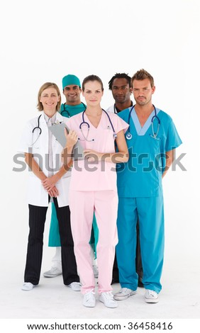Confident international team of doctors looking at the camera - stock photo
