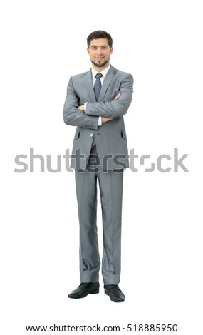 confident is a successful businessman in gray suit standing with
