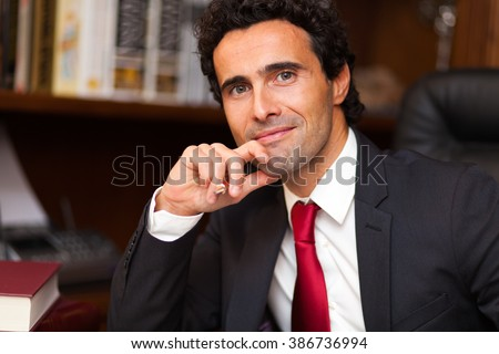 Confident lawyer in his studio  - stock photo