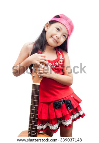 Confident little girl standing with her guitar. - stock photo