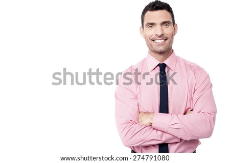 Confident male executive posing with folded arms